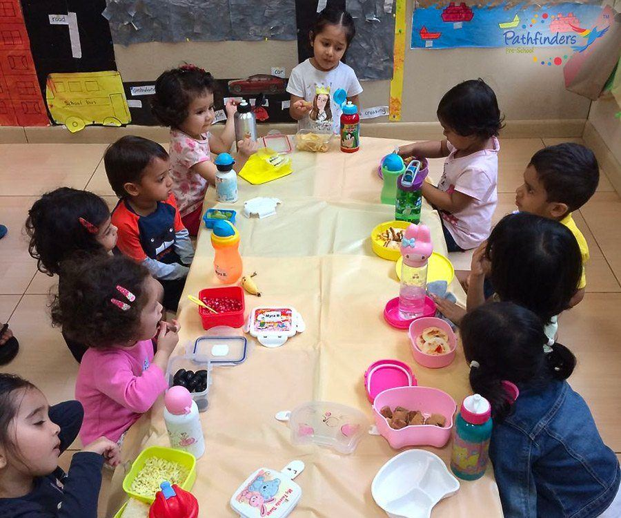 Children are enjoying their food together