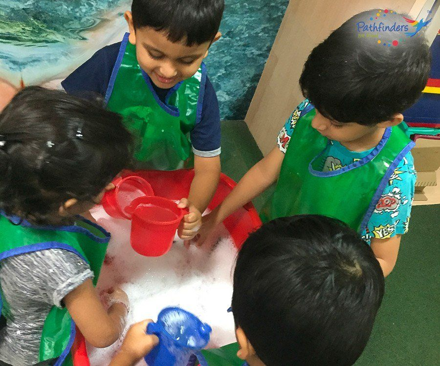 Children are playing with the soap water