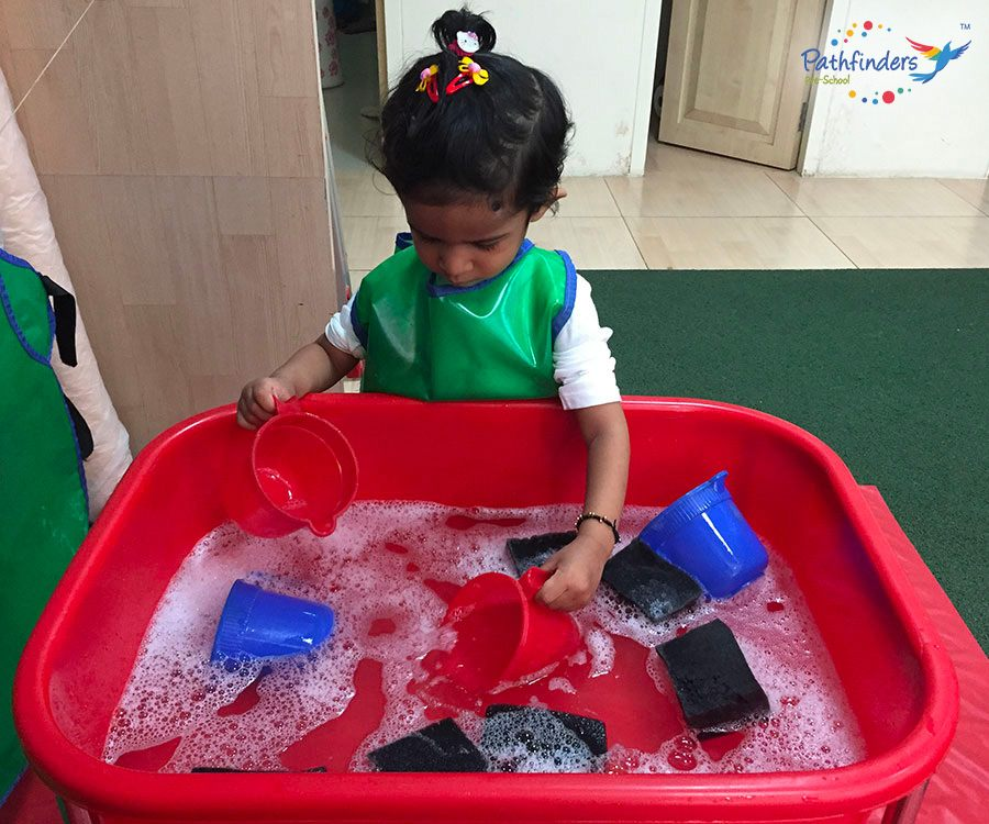 A child playing with soap water