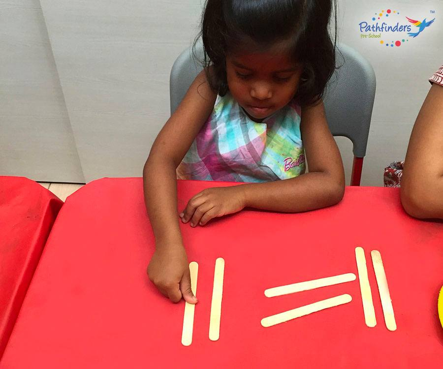 A child learning with ice cream sticks