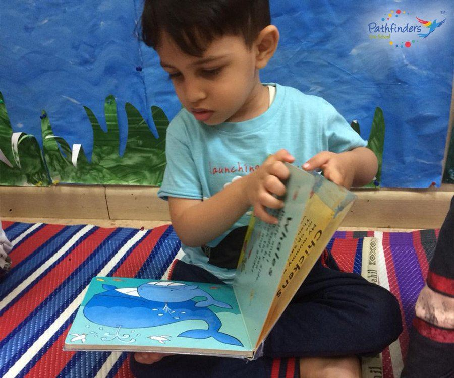Child observing a painting from the book