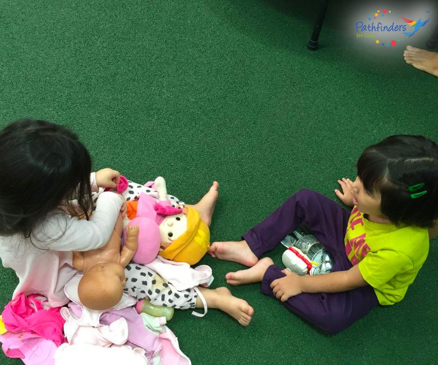 Girls are playing with the dolls.