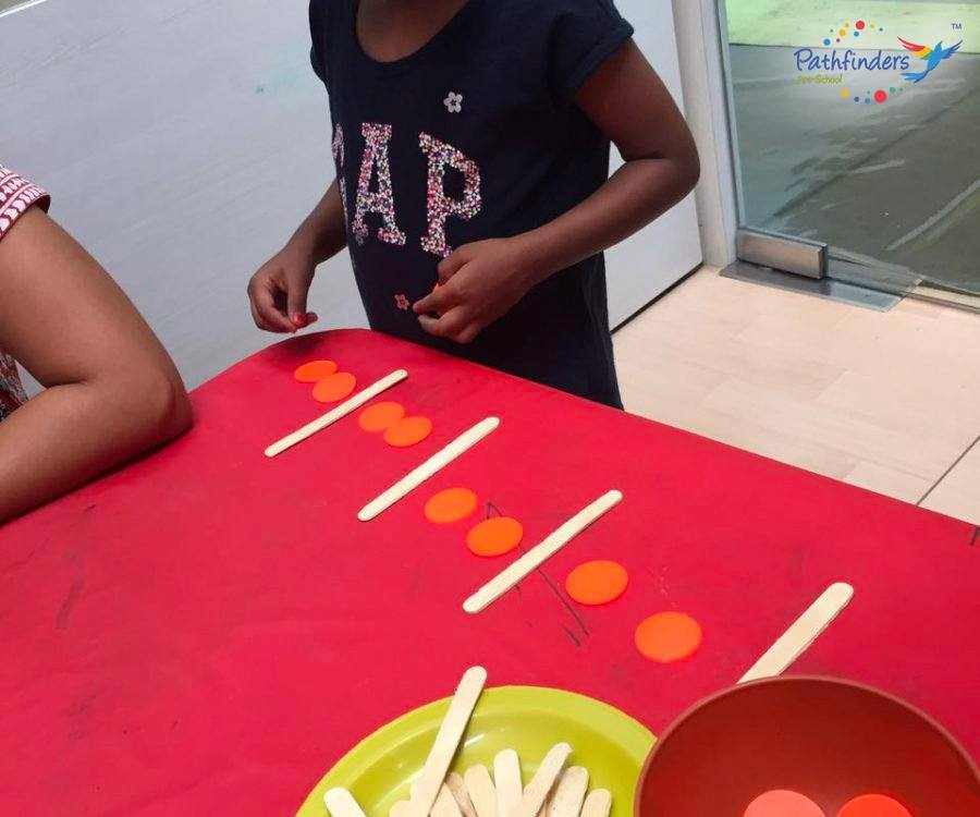 a child is learning with the ice cream sticks