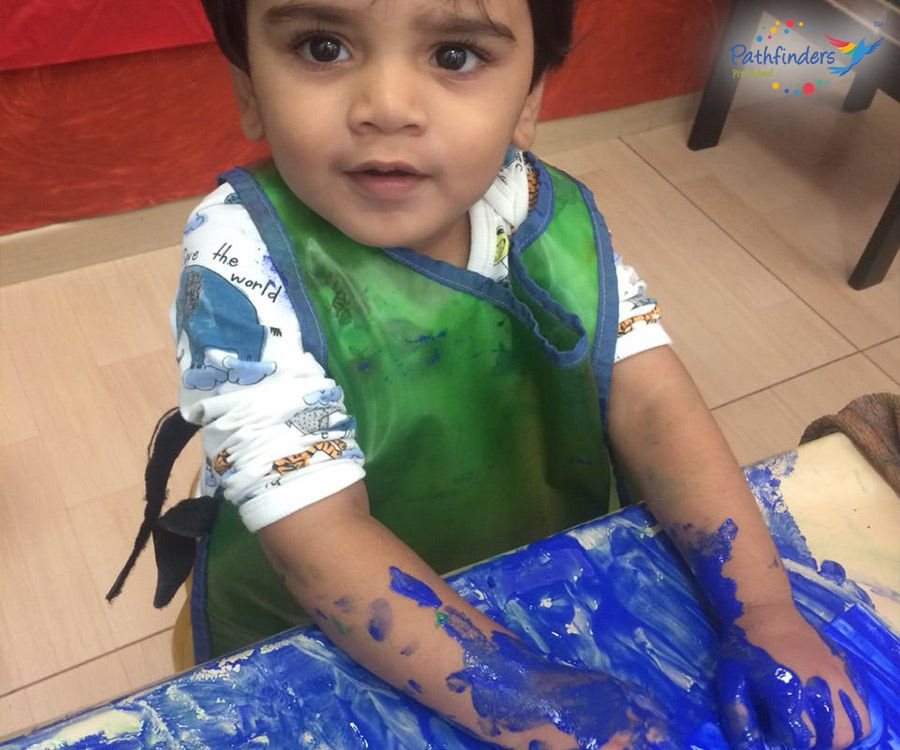 a child is enjoying with the colors