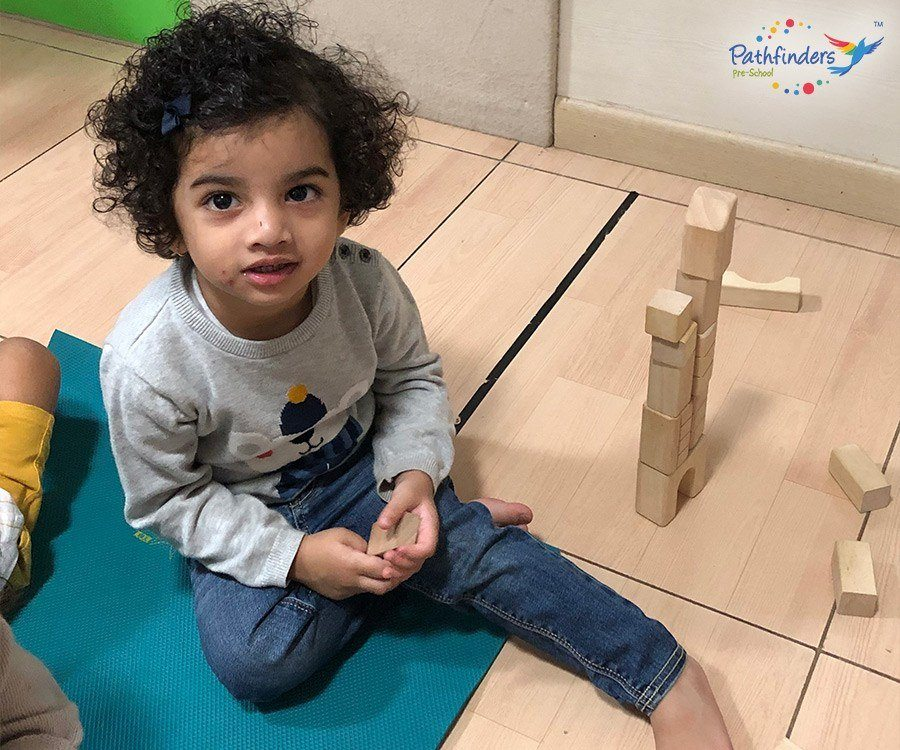 Child playing with wooden blocks - Foundation